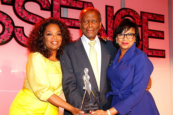 Sidney Portier and Oprah Winfrey present the Trailblazer Award to Cheryl Boone Isaacs at the Essence Black Women in Hollywood luncheon in February 2013