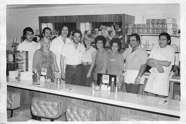 Ron Peskin and his wife (fifth and sixth from the eft) in the Northridge location shortly after Ron's purchase