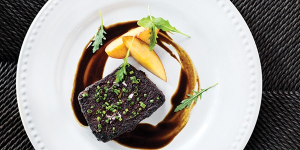 The duck at Broken Spanish is served with a sesame mole and persimmon